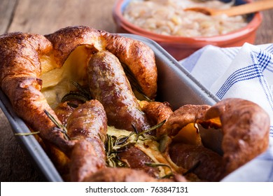 Baked sausages in Yorkshire pudding batter and served with  onion gravy, toad in the hole