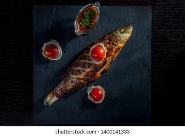 Baked Sea Bass With Cherry Tomatoes