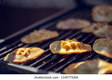 Baked sheep cheese on a grill grille. Polish regional sheep's cheese produced in the mountains.