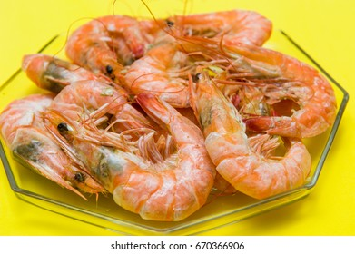 Baked shrimp, delicious seafood with yellow background.