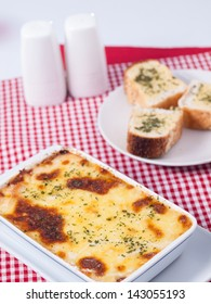 baked spinach with cheese  and garlic bread