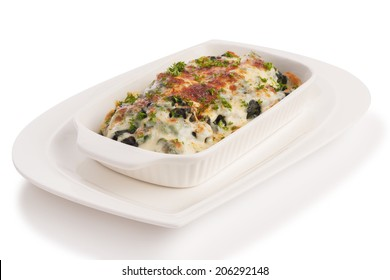 baked spinach with cheese isolated on white.