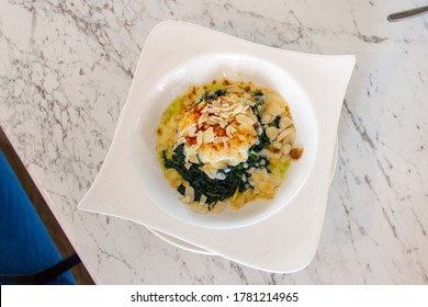 Baked Spinach with Cheese on white dish