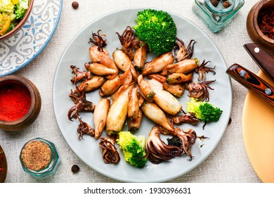 Baked squid stuffed with broccoli.Delicious fried calamari