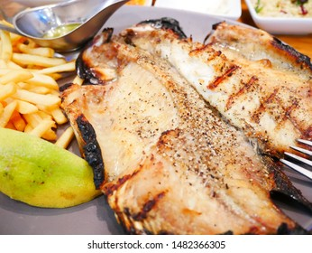 Baked St Peters Fish and French Fries