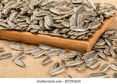 baked sunflower seeds in the wooden plate