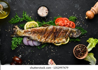 Baked Trout with Vegetables. Top view. Free space for your text. Rustic style.
