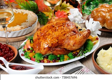 Baked turkey with vegetables, pumpkin pie, mashed potatoes, garlic buns and