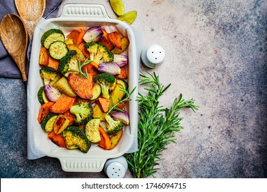 Baked vegetables in the oven dish. Baked sweet potato, zucchini and broccoli. Healthy vegan food concept.