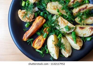 Baked vegetables - potatoes, carrots and cauliflower - Vegetarian menu