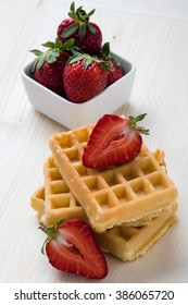 baked waffle with strawberry on white table
