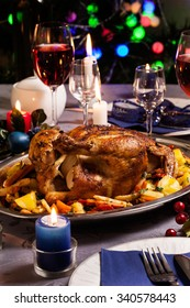 Baked whole chicken for Christmas dinner on festive table