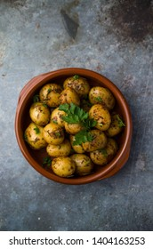 Baked young potatoes in clay bowls, tapas