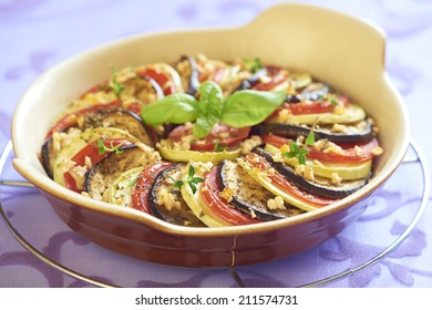 Baked zucchini, tomatoes and eggplant with garlic and herbs