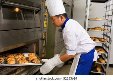 Baker holding the sweet bread fresh from the oven
