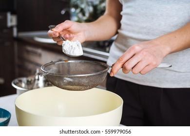 Baker sieve flour before kneading