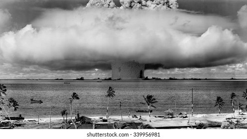 The BAKER test of Operation Crossroads, July 25, 1946. Seconds after the water column rose, and formed a condensation cloud, it fell back, unleashing a billowing base surge forming a 500 foot high wal
