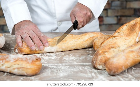 baker with traditional bread french baguettes