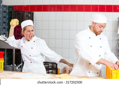 Baker who is frustrated with collegue throwing dough at him