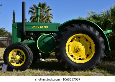 BAKERSFIELD, CA - APRIL 14, 2018: A two cylinder 1944 John Deere tractor is drawing lots of attention at the 6th annual Friends of Seniors Day Car Show.