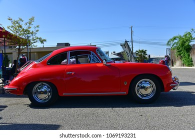 BAKERSFIELD, CA - APRIL 14, 2018: This beautifully restored and maintained bright red 1956 Porsche 356B is appearing today at the 6th annual Friends of Seniors Day Car.