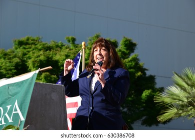 BAKERSFIELD, CA - APRIL 29, 2017: Wendy Reed, a recent candidate for 21st District Congressional Representative, addresses  crowd during the local version of the People's Climate March.
