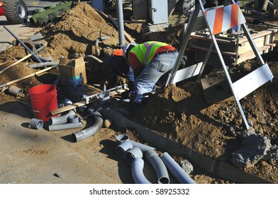 BAKERSFIELD, CA - AUG 12: Electricians completely replace traffic signals, poles and mast arms at a major intersection on August 12, 2010, at Bakersfield, California. Underground conduit is repaired.