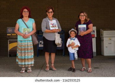 BAKERSFIELD, CA - AUGUST 16, 2018: These Jehovah's Witnesses are giving away their publication, The Watchtower, to passing pedestrians.