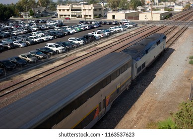 BAKERSFIELD, CA - AUGUST 23, 2018: Amtrak California Train No. 713 pulls out of the station heading north up the San Joaquin Valley and eventually to the San Francisco Bay area.