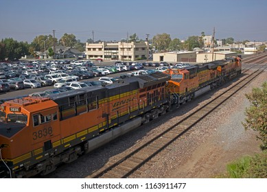 BAKERSFIELD, CA - AUGUST 23, 2018: Burlington Northern Santa Fe diesel-electric engines are coupled together, ready to pull a loaded train north up the San Joaquin Valley.