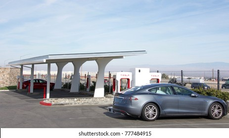 Bakersfield, CA - December 18, 2017: Tesla Super Charging station at Tejon Ranch. Tesla Supercharger stations allow Tesla cars to be fast-charged at the network within an hour.