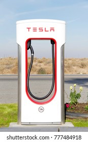 Bakersfield, CA - December 18, 2017: Tesla Super Charging station on Stockdale Hwy and the 5 fwy. Tesla Supercharger stations allow Tesla cars to be fast-charged at the network within an hour.