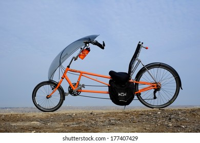 BAKERSFIELD, CA -  FEB 17, 2014: The long wheelbase Easy Racers Gold Rush recumbent bicycle is a human-powered alternative transportation solution for commuting to the office or touring the country.