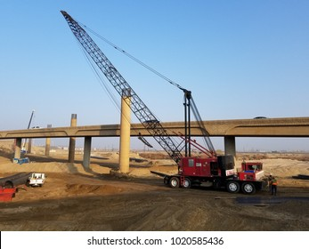 BAKERSFIELD, CA - FEBRUARY 6, 2018: Large concrete columns are in all stages of completion during construction of the Kern River Bridge Improvements Project.