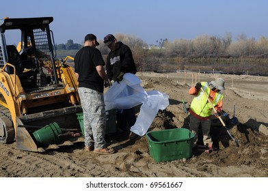 BAKERSFIELD, CA - JAN 22: Construction crew is installing underground utilities for the Kern River Upland and River Edge Restoration Project on January 22, 2011, at Bakersfield, California.