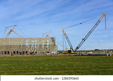 BAKERSFIELD, CA -  JANUARY 16, 2019: Construction of Amazon's fulfillment center is underway. Concrete tiltup walls are raised showing the warehouse's massive dimensions.
