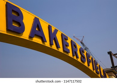 "BAKERSFIELD, CA - JULY 31, 2018: The iconic landmark ""BAKERSFIELD"" sign was originally erected across Union Avenue in 1949. It was demolished and a replica built in 1999, spanning Sillect Avenue."