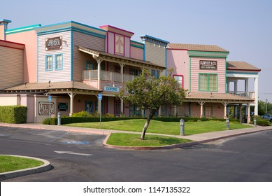 BAKERSFIELD, CA - JULY 31, 2018: Buck Owens' Crystal Palace is a popular tourist venue to hear country and western music. The architecture follows an old west motif.