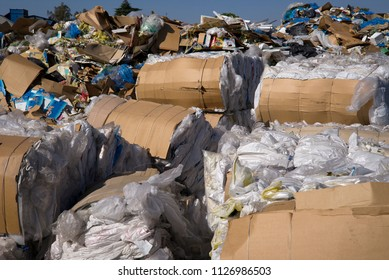 BAKERSFIELD, CA - JULY 4, 2018: A large recycling center houses stacks and piles and bundles of various materials soon to be transported to processing plants for reuse.