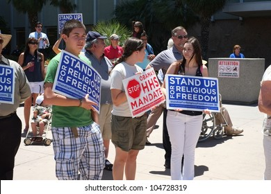 BAKERSFIELD, CA - JUN 8: Unidentified participants show protest signs at the Stand Up for Religious Freedom Rally to object to the HHS health care mandate on June 8, 2012,  in Bakersfield, California.