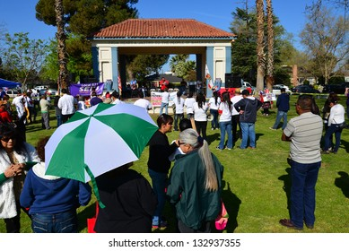 BAKERSFIELD, CA - MAR 24: Enthusiastic participants gather and get ready to march at a rally for a new immigration law on Cesar Chavez Day on March 24, 2013,  in Bakersfield, California.