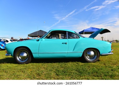 """BAKERSFIELD, CA - MARCH 14, 2015: A rear engined 1965 Karmann Ghia, based on the Volkswagon chassis,  in bright turquoise paint, is exhibited at the """"Cruisin' for a Wish"""" classic car show"""