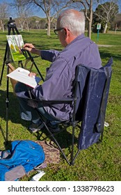 BAKERSFIELD, CA - MARCH 14, 2019: Like many retired people, Bill Temple enjoys getting out to the park with paints and easel.