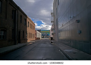 BAKERSFIELD, CA - MARCH 2, 2012: A winter rain has washed everything clean in a downtown alley.