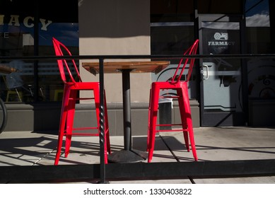BAKERSFIELD, CA - MARCH 2, 2019: Tables and chairs at this outdoor eating area are empty due to chilly winter weather.