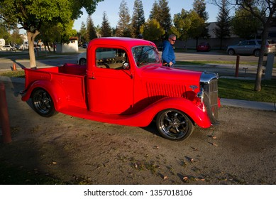 BAKERSFIELD, CA - MARCH 30, 2019 A 1936 Ford pickup truck can't be ignored in its bright red paint as the Coffee and Cars event  gets underway today.