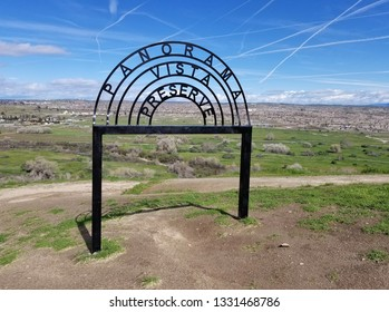 BAKERSFIELD, CA - MARCH 6, 2019: The view on high from Panorama Park is mostly of the Kern County oil fields with the Sierra Nevada mountains in the background.