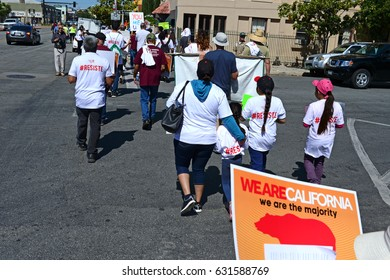 BAKERSFIELD, CA - MAY 1, 2017: United Farm Workers and Sierra Club stage a May Day march to observe the National Day of Action and register protests against the Trump administration.
