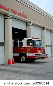 BAKERSFIELD, CA - MAY 21, 2015: A fire truck with firemen personnel departs the Central Fire Station after receiving a call.