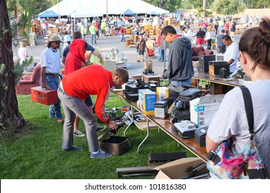 """BAKERSFIELD, CA - MAY 4: Many people turn out to eye merchandise and shop for bargains at the """"Junk-a-Tique"""" huge yard sale held by the Calvary Bible Church on May 4, 2012,  in Bakersfield, California"""